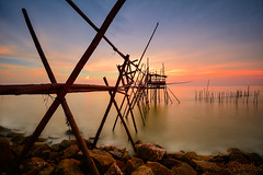 Fragile (zollatiff) Tags: ocean longexposure travel blue light sunset sea sky orange sun seascape reflection beach nature water colors silhouette yellow clouds sunrise landscape evening pier twilight nikon scenery rocks outdoor dusk stones jetty horizon structures peaceful bamboo harmony malaysia serene scape fragile tranquil johor goldenhour foreground fishingvillage waterscape leadingline fishermenvillage senggarang sungailurus nikond7100 zollatiff nikkor1012