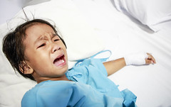 Sick little girl crying (Bugphai ;-)) Tags: sleeping people color girl horizontal female hospital asian thailand happy person one thirties kid pain bed healthy child image fear down patient equipment medical indoors ill health thai medicine inside dread resting ward brunette sickness cry care lying sick problems saline healthcare mid infection illness ache recuperation unwell recovering ailment