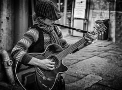 the girl with the guitar (Daz Smith) Tags: dazsmith fujixt10 fuji xt10 andwhite bath city streetphotography people candid canon portrait citylife thecity urban streets uk monochrome blancoynegro blackandwhite mono woman girl guitar cap hat music musician busking busker