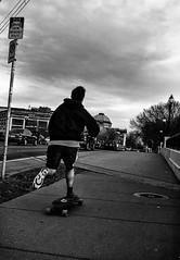 Mid-winter skate (TwinCitiesSeen) Tags: blackandwhite people canont3i tamron2875mm minnesota minneapolis universityofminnesota dinkytown twincities twincitiesseen