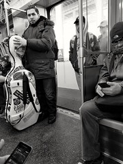 Morning vignettes - we all have our passions (williamw60640) Tags: streetphotography chicago chicagotransitauthority blackandwhitephotography elevatedtrain transit man commuters