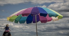 Under My Umbrella, Oka Beach (BeyondThePrism) Tags: park morning sky cloud sun color colour beach up clouds umbrella nationalpark kid rainbow nikon colorful day afternoon child cloudy pov father lookingup lookup pointofview parent national desaturated colourful incubus piggyback oka upwards queensofthestoneage morningview parasole d5200 okacrisis nikond5200