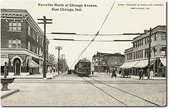 Forsyth Avenue north of Chicago Avenue, East Chicago, Indiana (Hoosier Recollections) Tags: people usa signs man men history industry buildings walking advertising awning indiana machinery transportation shops pedestrians cigars storefronts interurban buggy buggies trolleys banks businesses lakecounty dentists eastchicago hoosierrecollections