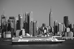 New York City Skyline and Cruise Ship (Frank Footer Fotos) Tags: new york city travel cruise sea vacation sky people urban usa white black holland art tourism water lines sunshine wall skyline architecture america docks vintage buildings river skyscape poster boats outdoors photography hotel bay pier office downtown wake cityscape skyscrapers state manhattan framed patterns taxi towers fine murals sunny landmark tourist tourists retro midtown business american empire sound buy jersey prints inlet hudson decor homeoffice channel strait waterway attractions yorker veendam