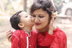 Never Ending Kisses (Russell John) Tags: red kiss mother son dhaka bangladesh pohelaboishakh dhanmondi explored 450d dhanmondilake 55250mm russelljohn