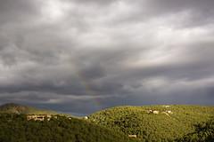 Rainbow near sunset (PierTom) Tags: newmexico santafe rain rainbow day