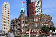 Rotterdam - Hotel New York (gerry.bates) Tags: building netherlands architecture port design rotterdam harbour flag structure clocktower cupola kopvanzuid hotelnewyork terasse marquees newyorkhotel hollandamerikakade hollandamericalijn hollandamericaquay