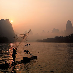 Fishing at dawn (Explored) by xiaomeisun (☺) (dbrout1) Tags: china travel sunrise landscape dawn liriver fisherman flickr accepted1of100 ostrellina absolutegoldenmasterpiece imagicland ifttt xiaomeisun asquaresuperstarstemple flickrstruereflectionexcellence trueexcellence1 ayrphotoscontestseaandsun