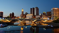 Columbus in Blue (tim.perdue) Tags: street city bridge blue columbus sunset ohio sky urban reflection water skyline architecture night river twilight long exposure downtown rich clear hour scioto