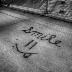 Smile, Your Not in Traffic! (Black and White) (Kevin MG) Tags: ca bridge blackandwhite bw usa streetart smile concrete graffiti words losangeles grafitti pavement text urbanart northridge