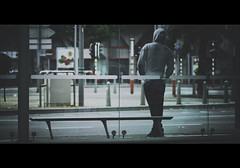 We Used To Be Thieves (BotaFriko) Tags: man waiting streetphotography busstop hoody cinematic d7000