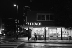 7-Eleven lights the corner (ahh.photo) Tags: street light blackandwhite bw man night corner dark walking orlando downtown cityscape fujifilm 7eleven xt1 xf23mmf14r