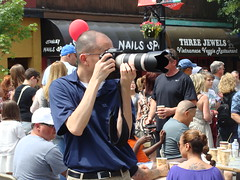 Photographer with Bald Head (knightbefore_99) Tags: camera italy car vancouver canon italian day photographer bc zoom candid bald free nails commercialdrive eastvan