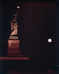 [Statue of Liberty and Rising Moon During Blackout] (SMU Central University Libraries) Tags: cityscapes statues monuments ektachrome sculptures libertyisland statueoflibertynationalmonument northeastblackoutof1965 electricpoweroutages