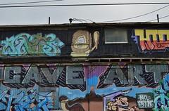 Cave Art (rickele) Tags: graffiti oakland mural cartoon prehistoric eastoakland fredflintstone barneyrubble theflintstones