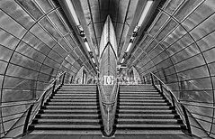 London Sci-Fi City (david gutierrez [ www.davidgutierrez.co.uk ]) Tags: city uk light urban blackandwhite london art monochrome architecture modern photography design arquitectura geometry metallic contemporary interior fineart perspective symmetry architectural londres scifi metropolis londonunderground londra futuristic cityoflondon londyn davidgutierrez pentaxk5