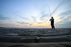 Vissen tijdens zonsondergang (Omroep Zeeland) Tags: sunset cloud strand fishing fisherman zonsondergang zeeland visser zon hengel zeeuws brouwersdam scharendijke