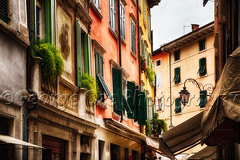 Classic Northern Italian Street View, Riva Del Garda (George Oze) Tags: travel italy horizontal architecture colorful europe glow fineart scenic streetphotography streetscene lakeside historic shutters balconies daytime charming quaint trentino italianalps awnings patina lakegarda fineartphotography rivadelgarda northernitaly colroful pastelcolors lowangleview traditionalhouses alpineregion buildingexteriors windowsandshutters