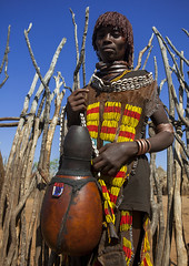 Girl Of The Hamer Tribe, In Traditional Outfit Holding A Calabash, Turmi, Omo Valley, Ethiopia (Eric Lafforg