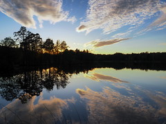 Evening lake (Jens Haggren) Tags: blue sunset sky lake water clouds reflections evening olympus omd em10