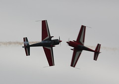 Extra 300S crossing (Matthew Douglass Aviation) Tags: plane canon airplane fly flying airport display aircraft aviation smoke air airplanes flight aeroplane airshow planes extra aeroplanes aero airfield airbase waddington 300s 550d
