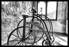 Ride the beast (marcobertarelli) Tags: ride biciclette wheels prototype old material museum portobuffolè bike monochrome monochromatic contrast light shadow geometry scene bw photography
