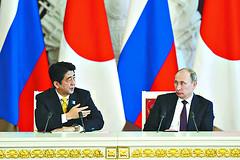安倍向中国示范日本的大度