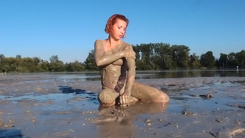 Sexy girls playing in mud