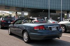 Chrysler Sebring convertible (Canadian Pacific) Tags: auto usa newyork canada car america niagarafalls us automobile crossing unitedstates border convertible canadian american chrysler sebring immigration rainbowbridge ofamerica aimg0007