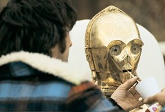 Giving Anthony Daniels a drink (Tom Simpson) Tags: film vintage starwars tunisia dunes scifi c3p0 behindthescenes anthonydaniels threepio