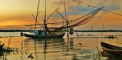 IMG_0105 - Fishing, Last catch of the day (golam_siddiqui) Tags: sunset sky nature water canon river landscape boat fishing dusk bangladesh