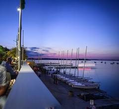 terrace view (almostsummersky) Tags: pink blue sunset people lake fall uw water wisconsin night sailboat boats pier dock view terrace dusk horizon flags deck madison uwmadison railing sailboats universityofwisconsin memorialunion lakemendota