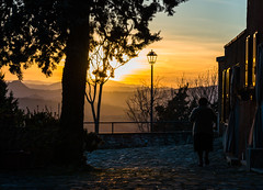 approaching the night (lucafabbricesena) Tags: montebello valmarecchia emiliaromagna italy evening sunset village lamp twilight nikon d800 oldwoman