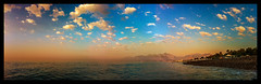 The woman in red (Melissa Maples) Tags: cameraphone morning blue sea summer panorama mountains beach apple water clouds turkey dawn asia mediterranean trkiye antalya iphone  iphone4 konyaaltzero