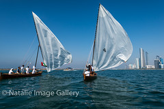 22ft Dhows - racing to the finish (Natalie.Imagegallery) Tags: wood blue red sea people orange white black green water skyline strand boats bay asia sailing towers uae middleeast silk sailors competition lagoon images racing abudhabi finish historical natalie mast ropes tradition breeze nylon winning seas dhow persiangulf thestart tonking unitedarabemirate conrniche dhowracing straditional natalietonkingimagegallery 22fr lifejacketscity
