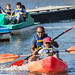 Father and Son Kayaking on Shoreline Lake