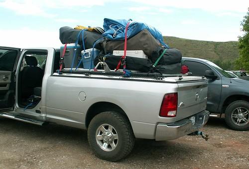 aluminum closed kayak pickuptruck dodge l raft hd ram polished diamondback diamondplate drybag tonneaucover truckbedcover dr09 cargoontop lightgrayorsilvertruck driversidetaillightview watercraftontop