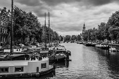 (McQuaide Photography (Away)) Tags: city blackandwhite bw holland water netherlands monochrome amsterdam canon eos blackwhite europe nederland wideangle dslr centrum stad uwa wideanglelens ultrawideangle 100d 1018mm mcquaidephotography