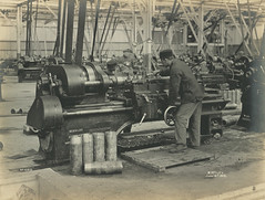 Rough facing (Tyne & Wear Archives & Museums) Tags: men wheel metal wall bar table handle boot shoe concentration belt sock factory pattern hand belgium symbol timber steel label coat debris letters pipe platform machine plate ceiling gateshead ring moustache beam number machinery cap numbers bolt cylinder trousers opening arrow ladder unusual ww1 dust grip blazer firstworldwar particles intricate cleanshaven industrialheritage blet elisabethville socialhistory operational blackandwhitephotograph comradeship birtley northeastofengland gunshells shellbody sirwgarmstrongwhitworthcoltd birtleybelgians 14june1916 nationalprojectilefactory shellmanufacture belgianworkers