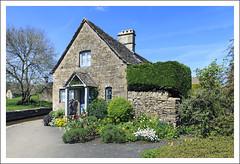 Quaint Cottage (Fazer44) Tags: flowers blue trees windows england sky plants house green wall village stones bricks cottage cotswolds porch quaint hedges lowerslaughter