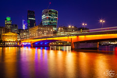 London Bridge (Umbreen Hafeez) Tags: city uk bridge blue light england reflection building bus london tower thames architecture night buildings reflections river dark twilight europe long exposure cityscape dusk low hour gb 42 cheesegrater walkie talkie