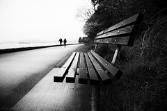 sense of time (bluechameleon) Tags: ocean trees people blackandwhite bw blur water vancouver bench boats moody bokeh ships parkbench tankers bluechameleon artlibre sharonwish bluechameleonphotography