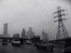 (eflon) Tags: bw distortion window glass monochrome downtown driving texas tx houston dreary raindrops raining lowres bldgs i45