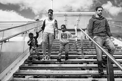 Cool kid! (My Kal) Tags: bridge woman white man black london kids children mono steps southbank waterloo riverthames fujifujifilmxpro118mmcandidpeoplestreetphotographylondonportraitnaturallight