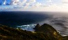 Cape Reinga (vamshi.koilkandadai) Tags: ocean blue sea green nature grey rocks waves pacific earth horizon gray scenic hills cape tasman crashing curvature reinga torquoise