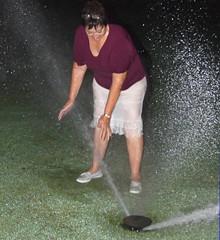 Golf course playful, 2012 (clarkfred33) Tags: sprinkler golfcourse soak drench wetadventure wetfun wetskirt clearwatercountryclub nighttime flashphoto mist spray wetclothes wetwoman wetlook nightadventure play enjoy