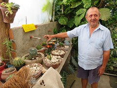 Friendly gardener next to the Lodge, Orchids etc (Hear and Their) Tags: fray benito holguin province cuba orchids orquidea garden gardener sale