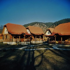 Zlatibor Cabins (sonofwalrus) Tags: holga film lomo lomography scan serbia europe zlatibor cabins shadows