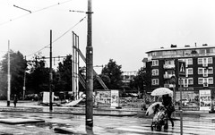Scan10018 (nydiavanvoorthuizen) Tags: rain amsterdam umbrella blackwhite olympus analogue olympusom2 insulindeweg