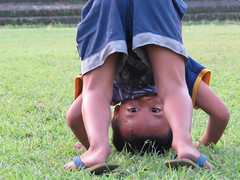 upside down (explore) (DOLCEVITALUX) Tags: boy playing happy kid child play happiness cartwheel canonpowershotsx50hs